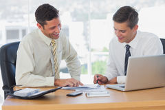 Happy businessmen working together and smiling Royalty Free Stock Image