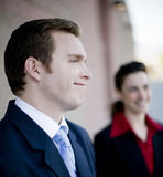 Happy businesspeople. Close view of two happy young businesspeople in formal wear royalty free stock photo