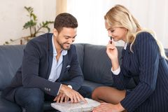 Happy businesspeople on business meeting talking about contract Stock Images