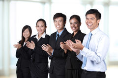 Happy businesspeople clapping in a meeting Stock Images
