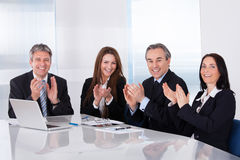 Happy Businesspeople Clapping Stock Photos