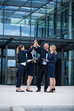 Happy businesspeople giving high five to each other Royalty Free Stock Photography
