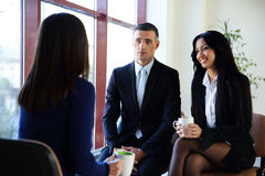 Happy businesspeople having coffee break Royalty Free Stock Photography