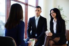 Happy businesspeople having coffee break Royalty Free Stock Photography