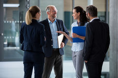 Happy businesspeople having a conversation Stock Photo