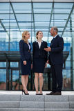 Happy businesspeople having a conversation Royalty Free Stock Images