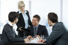 Happy businesspeople at meeting Royalty Free Stock Photos