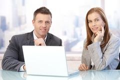 Happy businesspeople at meeting stock images