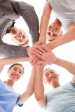 Happy businesspeople placing their hands top of each other royalty free stock image