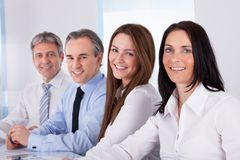Happy businesspeople in a row Stock Photo