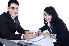 Happy businesspeople signing business contract Stock Photo