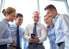 Happy businesspeople with smartphone Royalty Free Stock Images