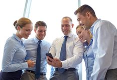 Happy businesspeople with smartphone Royalty Free Stock Photo