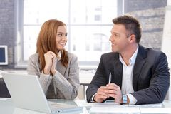 Happy businesspeople smiling at each other Stock Images