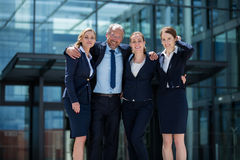 Happy businesspeople standing in office premises. Portrait of happy businesspeople standing in office premises Royalty Free Stock Photo
