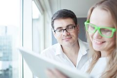 Happy businesspeople working with tablet PC in the Royalty Free Stock Images