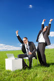 Happy businesspersons looking at laptop Royalty Free Stock Image