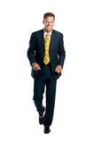 Happy businesssman walking Royalty Free Stock Images