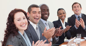 Happy businessteam clapping in a meeting Stock Images