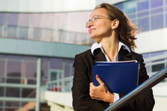 Happy businesswoman with a folder Royalty Free Stock Photography