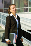 Happy businesswoman at the airport. Royalty Free Stock Photography