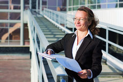 Happy businesswoman at the airport. Royalty Free Stock Image
