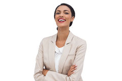Happy businesswoman with arms crossed Stock Photography
