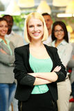 Happy businesswoman with arms folded Stock Images