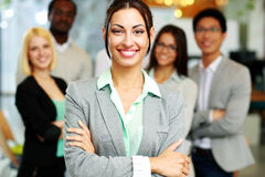 Happy businesswoman with arms folded Royalty Free Stock Photos