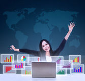 Happy businesswoman with bar graphs Royalty Free Stock Image