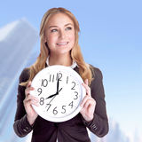 Happy businesswoman with big clock Royalty Free Stock Photography
