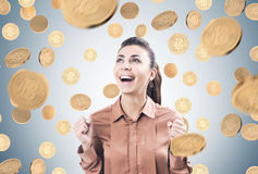 Happy businesswoman, bitcoin rain Stock Photos