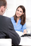 Happy businesswoman in a blue blouse in interview or meeting Stock Image