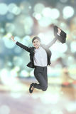Happy businesswoman with bokeh background Royalty Free Stock Photo
