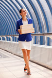Happy businesswoman with boxes Royalty Free Stock Images