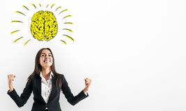 Happy businesswoman with brain sketch royalty free stock images