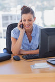 Happy businesswoman calling Royalty Free Stock Photo
