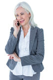 Happy businesswoman calling with smartphone Stock Images