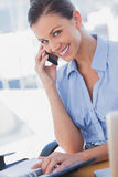 Happy businesswoman calling and smiling Royalty Free Stock Image