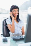 Happy businesswoman calling someone with her mobile phone Stock Photography