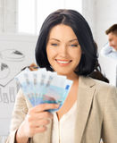 Happy businesswoman with cash money in office Royalty Free Stock Photos