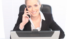 Happy Businesswoman On Cell Phone Stock Photo