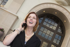 Happy Businesswoman On Cell Phone in Front of City Hall Royalty Free Stock Photos