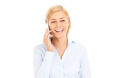 Happy businesswoman with a cellphone stock image