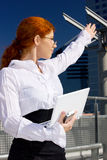 Happy businesswoman in the city Royalty Free Stock Image