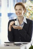 Happy businesswoman with coffee cup Royalty Free Stock Photo