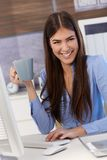Happy businesswoman with coffee mug Stock Photo