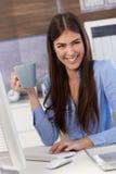 Happy businesswoman with coffee mug Stock Photo