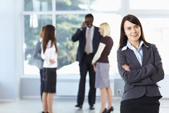 Happy businesswoman with colleagues Royalty Free Stock Photos