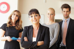 Happy businesswoman with colleagues in the background Royalty Free Stock Image